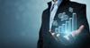 Investissement locatif Bordeaux –  homme tenant un graphique 3D avec dans sa main
