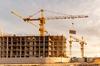 Friche Terrefort – Trois grues sur un chantier de construction en cours