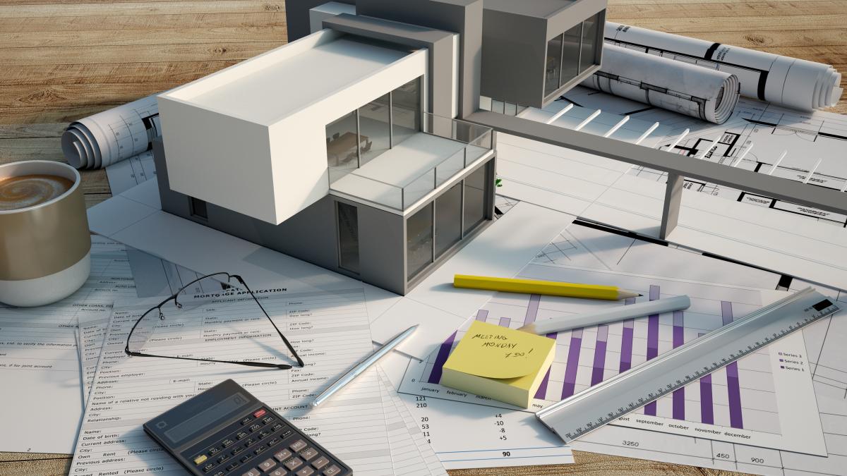 Maison modulable – Vue d'une maquette de maison neuve posée sur des plans